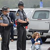Pennsylvania State troopers stand next to a weeping parent during a mock crash acted out at Owen J. Roberts High School Thursday. <br /> Marian Dennis -- Digital First Media