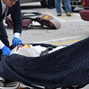 A student from Owen J. Roberts High School takes part in the mock crash that was reenacted Thursday. Volunteers from Houck & Gofus Funeral Home place a student in a body bag for effect.<br /> Marian Dennis -- Digital First Media
