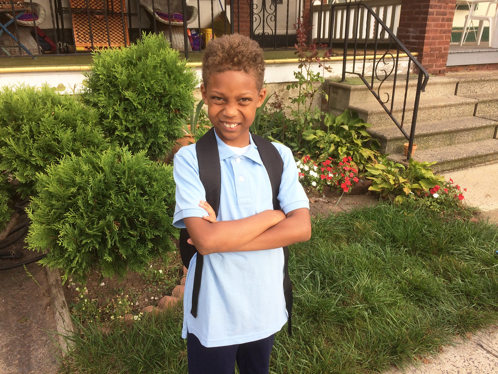 . Derekii Seals, 8, walked to Lincoln Elementary School Monday for his first day as a third grader in Jill Bolonski\'s class. Evan Brandt -- Digital First Media
