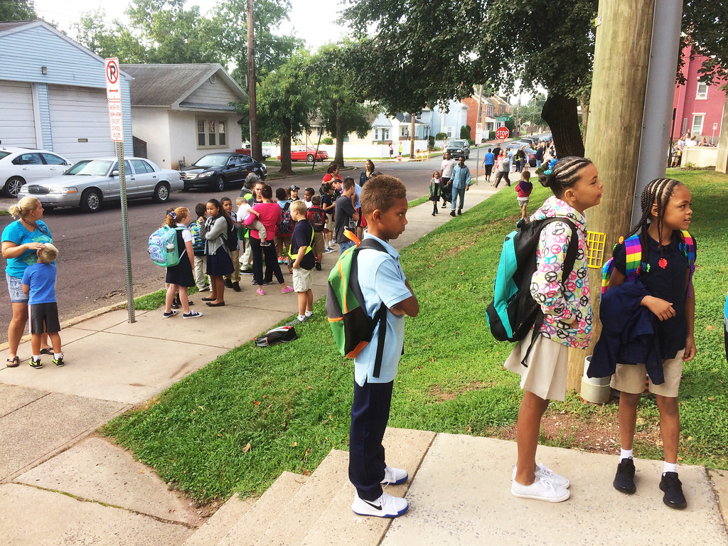 . Third graders line up at the York Street entrance to Lincoln Elementary on the first day of school Monday. Evan Brandt -- Digital First Media
