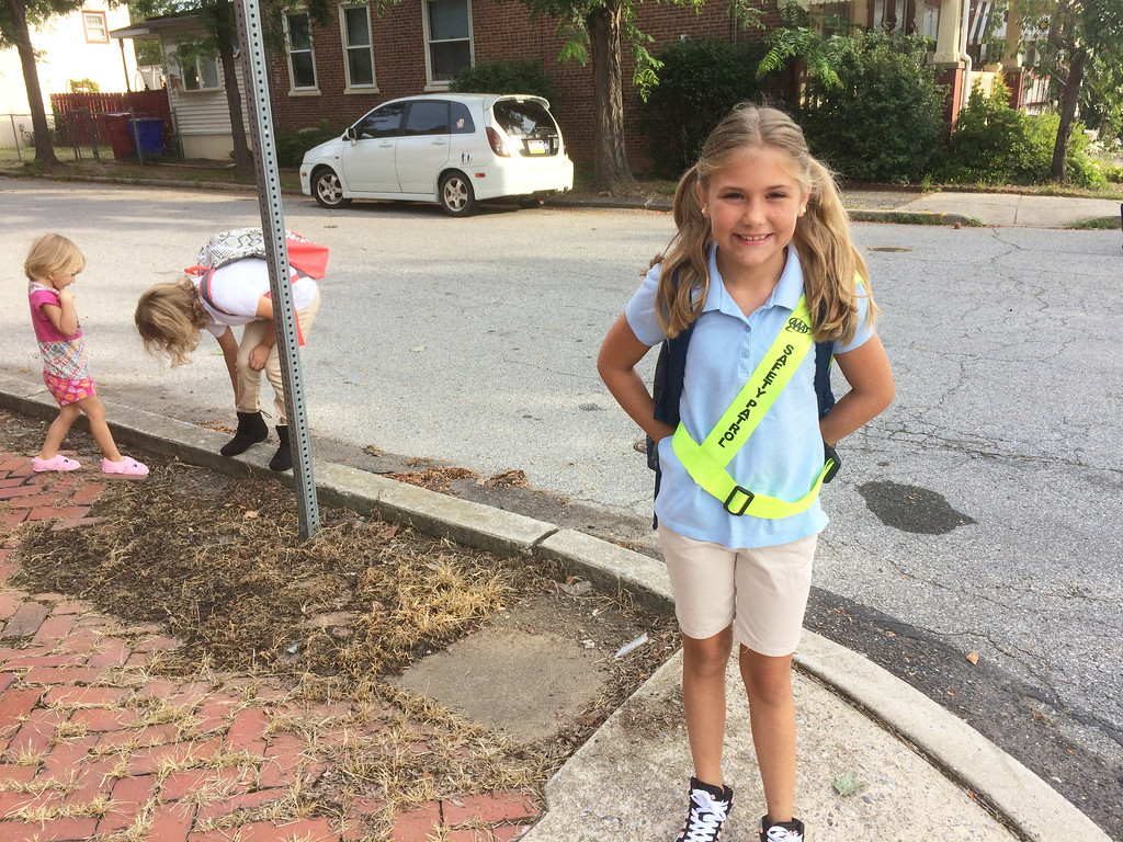 . Lincoln Elementary School fourth grader Lily Felix, 9, took up her post as the safety patrol officer for the busy corner of Sixth and York streets for the first time Monday. Evan Brandt -- Digital First Media
