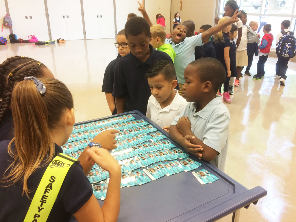 . As students line up to receive their IDs during the first day at school at Lincoln Elementary School, some just can\'t help mugging for the camera. Evan Brandt -- Digital First Media.