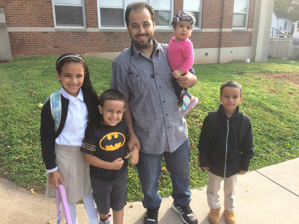 . Lincoln Elementary second grader Shaded Al-Jashoubi, left, had a little company for her first day of school. With her are, from left, her brother Hamid, 4, her father Abdel, Hathem, 7 months, and Yusuf, 7. Evan Brandt -- Digital First Media