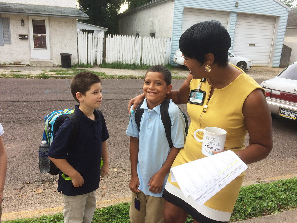 . Lincoln Elementary School Principal Calista Boyer, right, greets third graders Danny Hoffman, left, and Eric Bridges on the first day of school Monday. Evan Brandt -- Digital First Media.