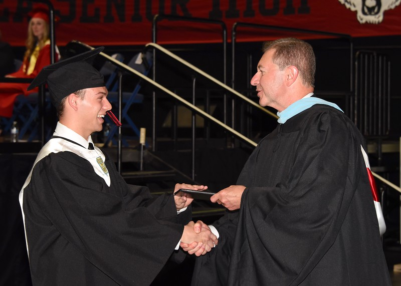 Photo by Jesi Yost<br /> Jason  W.  Carr  receives  his  diploma.