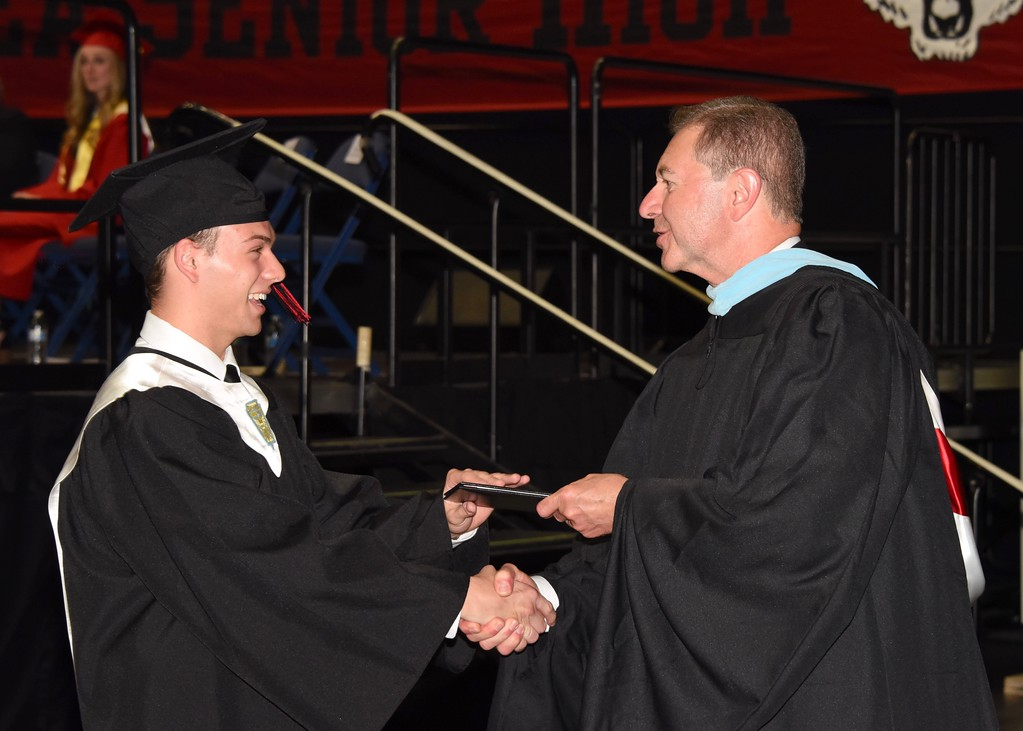 . Photo by Jesi Yost Jason  W.  Carr  receives  his  diploma.