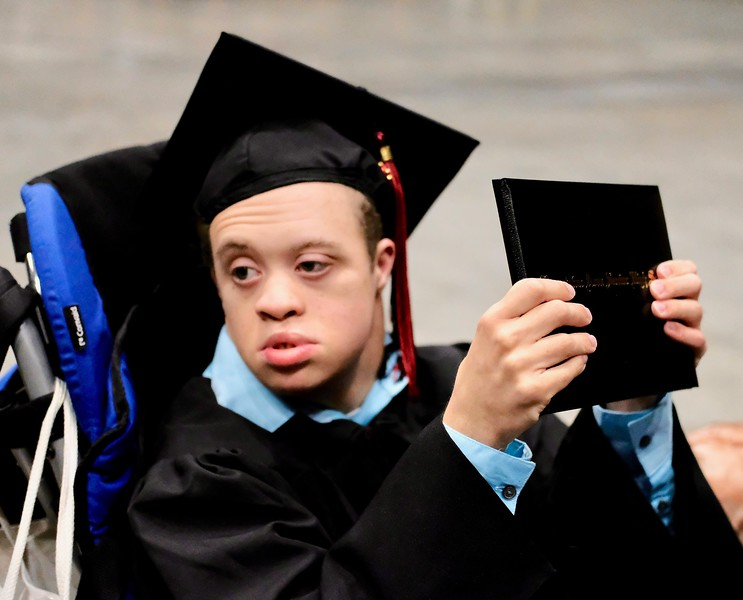 Photo by Jesi Yost<br /> Anthony  Jaylan  Grey  with  his  diploma.