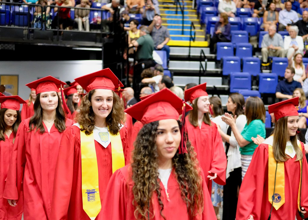 . Photo by Jesi Yost Boyertown  teachers  line  up  and  applaud  the  graduates  as  they  enter  the arena.
