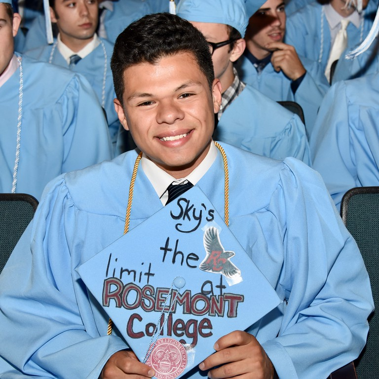 . Jesi Yost � For Digital First Media Daniel Boone senior Luis Barrales Jr. shows his graduation cap, decorated with Rosemont College, where Barrales will be attending in the fall.
