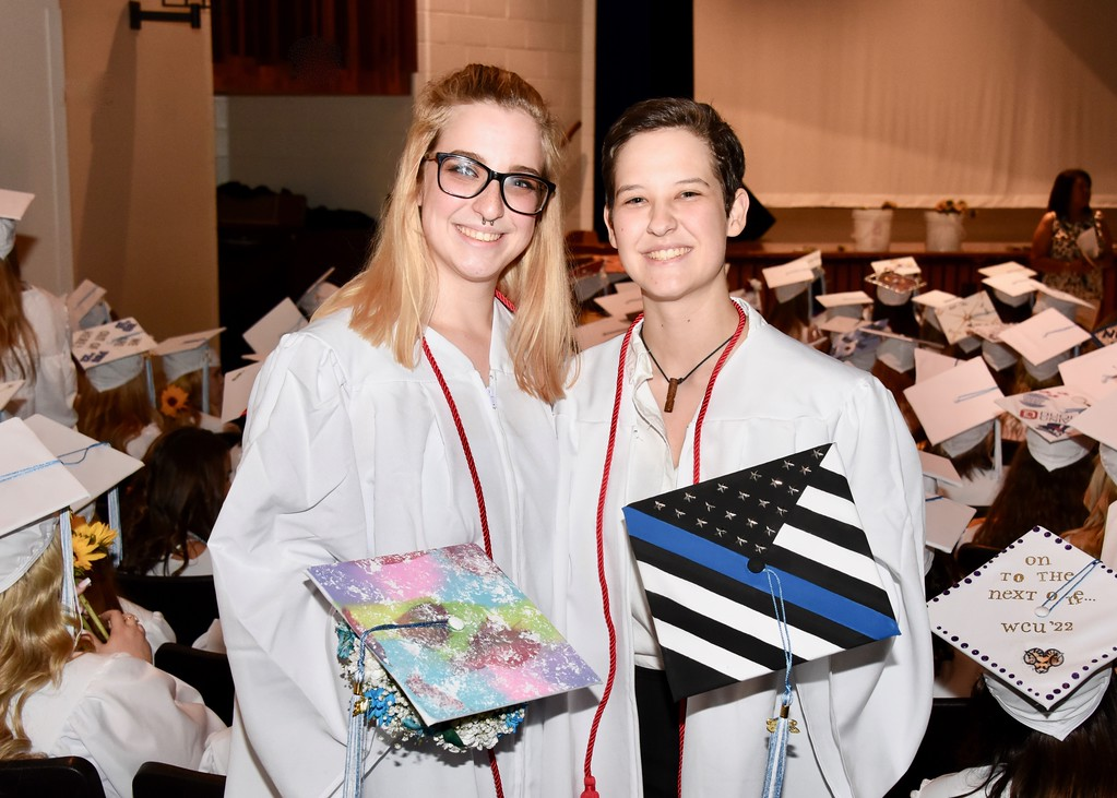 . Jesi Yost � For Digital First Media Twins Abby and Emily Dlhopolsky display their decorated mortar boards. The sisters were part of Daniel Boone High School�s class of 2018.