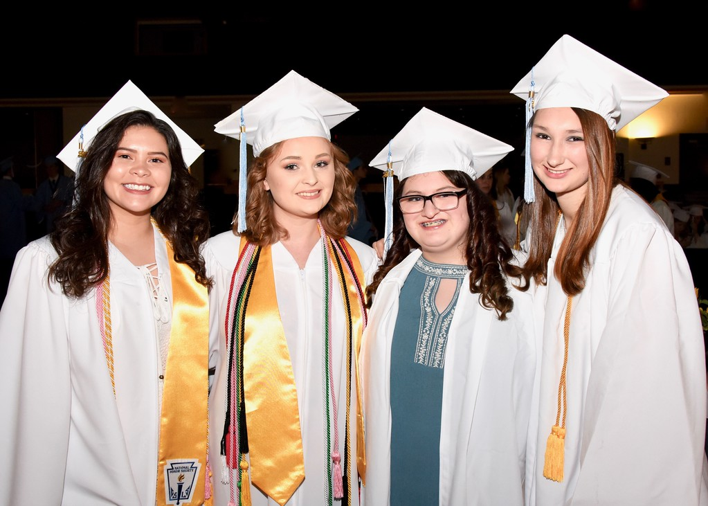 . Jesi Yost � For Digital First Media Erin Coughenour, Elizabeth Cote, Kaitlyn Cooper and Jessica Confer prepare to celebrate their graduation from Daniel Boone High School on Friday.