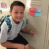 Fourth grader Brandon  Schutter, 10, finds his new locker in the new St. Aloysius Parish School on Monday.