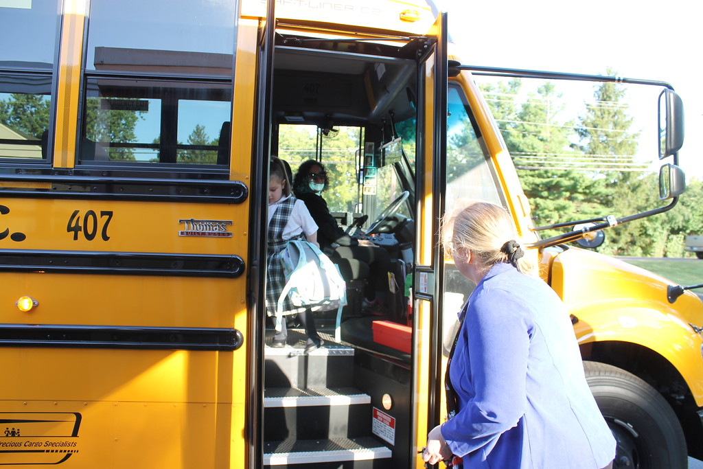 . New St. Aloysius Parish School Principal Kathleen Bruce greets students on the first day of school Monday in the school\'s new location, the former St. Pius X High School on North keim Street.