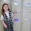 Student Julia Ross shows off her new locker during her first day back at St. Aloysius Parish School Monday.