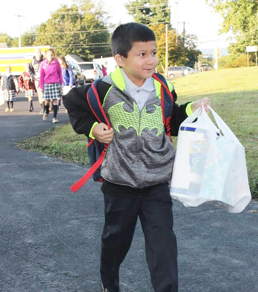 . Perhaps this young St. Aloysius Parish School student should have put his family\'s donation of paper goods into his utility belt.