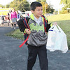 Perhaps this young St. Aloysius Parish School student should have put his family's donation of paper goods into his utility belt.