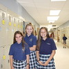 These St. Aloysius Parish School students were all smiles Monday as they explored the new building, the former St. Pius X High School, which came complete with lockers, a luxury they had not had before.