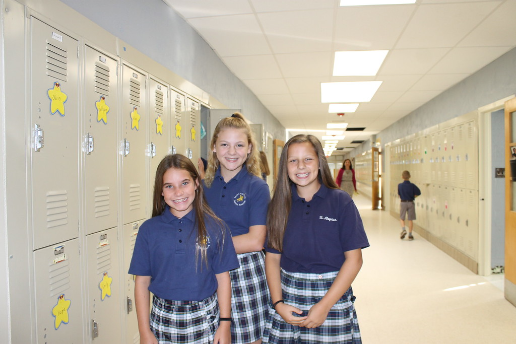 . These St. Aloysius Parish School students were all smiles Monday as they explored the new building, the former St. Pius X High School, which came complete with lockers, a luxury they had not had before.