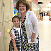 St. Aloysius Parish School 2nd grader Brooke Schutter,  7, is welcomed on the first day of school in the new building by a teacher.