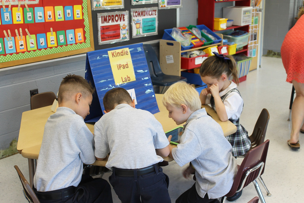 . Young St. Aloysius Parish School students check out the school\'s iPad supply during the first day of school Monday.