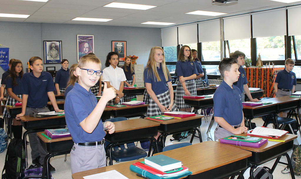 . Students at St. Aloysius Parish School gave the thumbs on on the first day of classes in the new building.