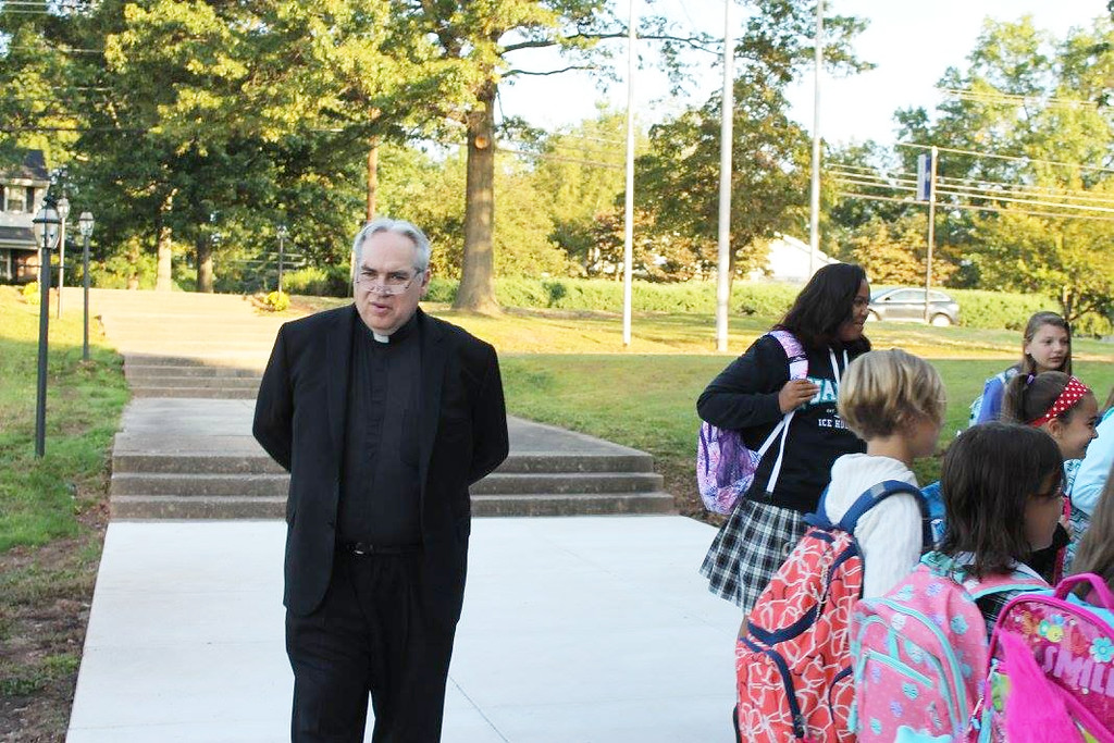 . The Rev. Joseph Maloney, pastor of St. Aloysius Parish, welcomes students to the new home of St. Aloysius Parish School in Lower Pottsgrove.