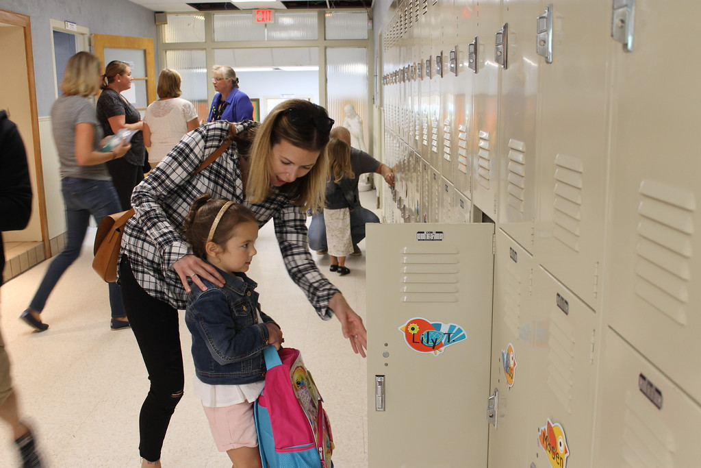 . St. Aoysius Parish School students never had lockers in the old building on North Hanover Street, and this young student seems to be eyeing hers warily.