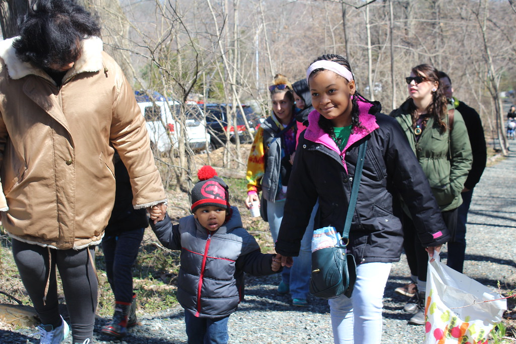 . Yvette Boggs, far left, walks with her grandchildren Jonah Richardson, 3, and Dora Siaway, 9, during the Althouse Arboretum forest egg hunt on Saturday.