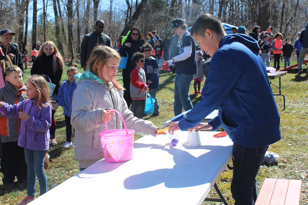. Families and children gather for fun and games after colleting Easter eggs along forest trails at the Althouse Arboretum in Upper Pottsgrove on Saturday.