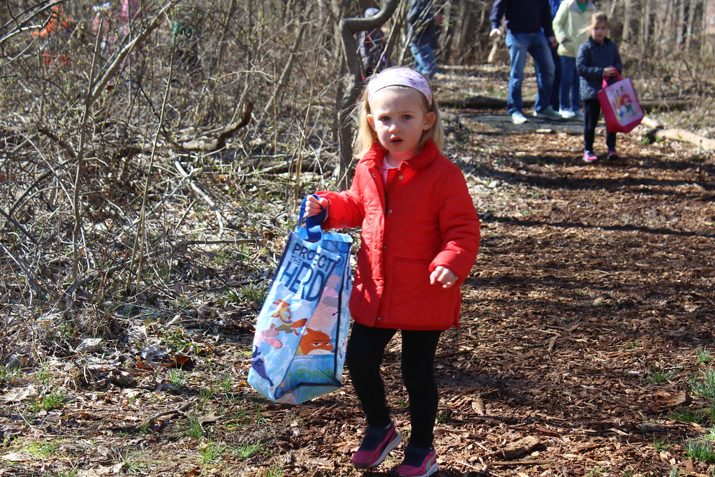 . Lyla Toepel, 3, walk through the trails of the Althouse Arboretum in Upper Pottsgrove looking for hidden plastic eggs on Saturday, April 8, 2017.