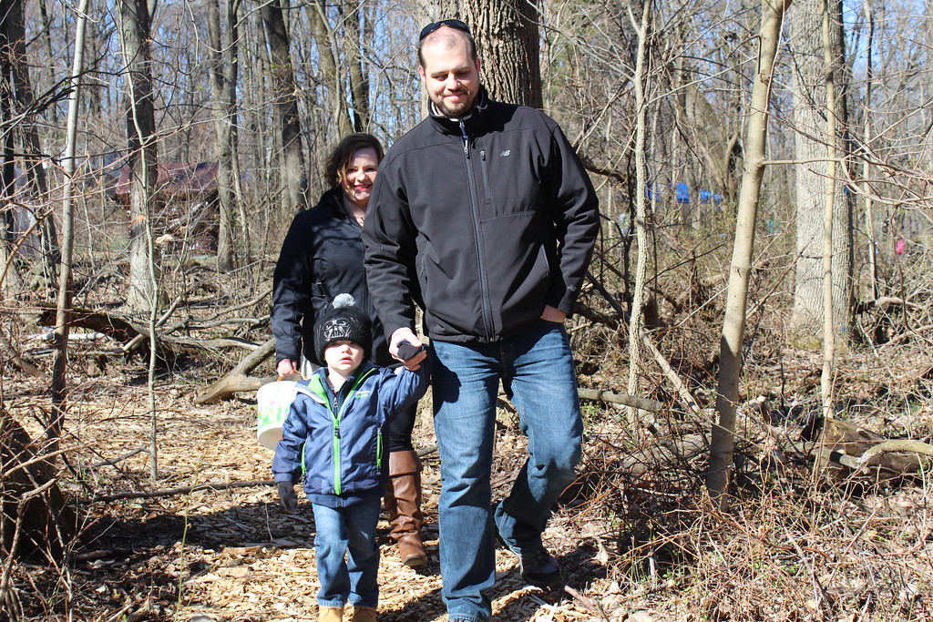 . Lisa and John Rawas walk with their son Bryan, 3, through the forested trails of the Althouse Arboretum for and Easter Egg hunt on Saturday, April 8, 2017.