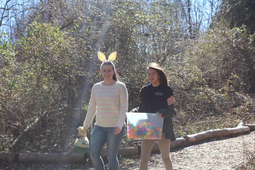 . From left to right, Pottsgrove High School students Macy Long, 16, and Alexis Cornwall, 17, hide plastic eggs along the forest trails of Althouse Arboretum for children to find on Saturday, April 8, 2017.