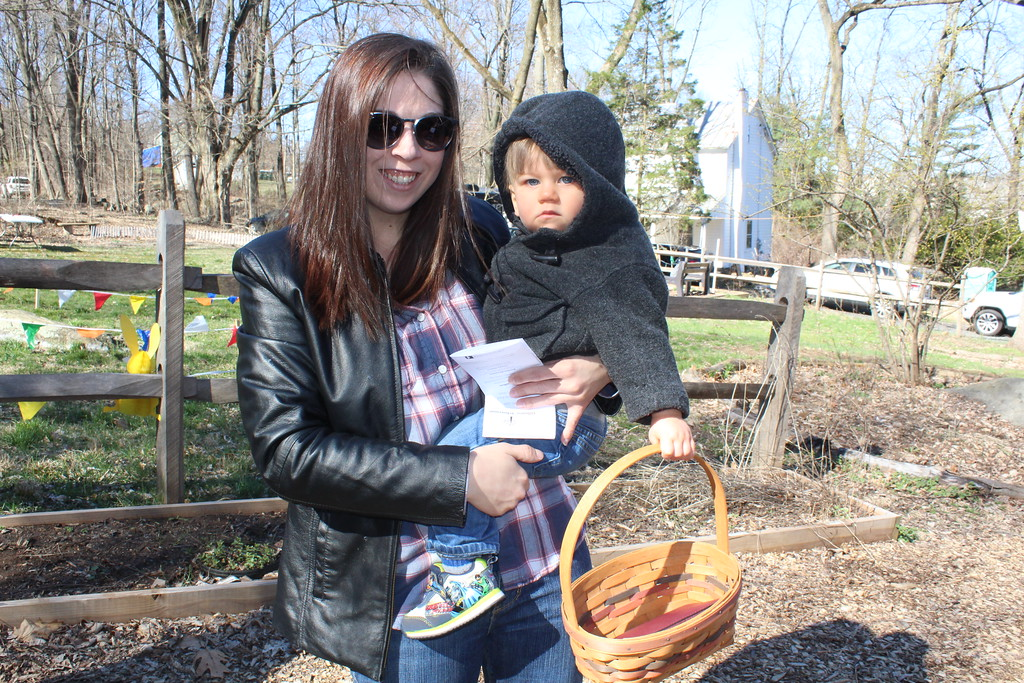 . Erin James, holds her son Travis,3, while they line up for the Forest Easter Egg Hunt at the Althouse Arboretum in Upper Pottsgrove on Saturday, April 8, 2017.