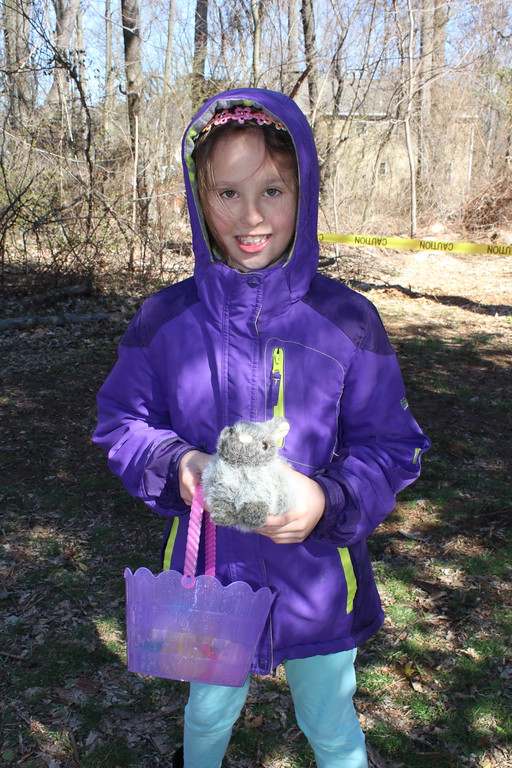 . Ava Sands, 6, holds a basket full of plastic eggs and a bunny she found during a forest egg hunt at the Althouse Arboretum in Upper Pottstgrove on Saturday, April 8, 2017.