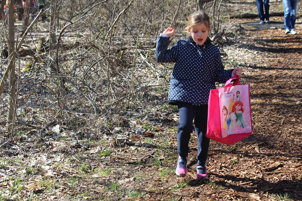 . Sloane Toepel, 5, walks in the forest at Althouse Aboretum for an Easter egg hunt on Saturday, April 8, 2017.