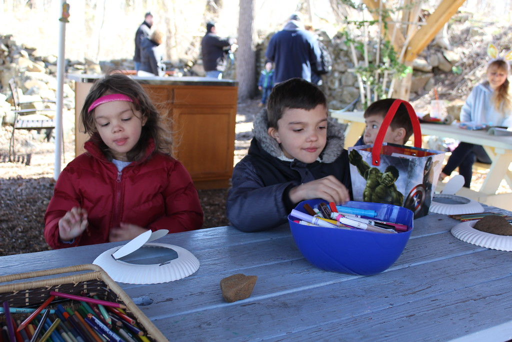 . Emily Maldonado, 5, and Justin Maldonado, 7, make bunny hats out of paper plates at the crafts table during the Atlhouse Arboretum Forest Easter Egg Hunt on Saturday, April 8, 2017.