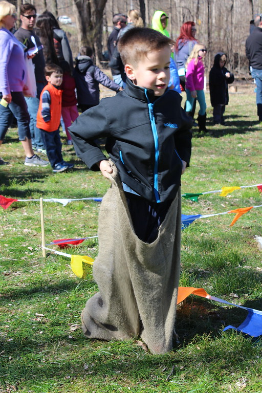 . Ryan Hackett, 6, goes participates in a sack race at the Althouse Arboretum in Upper Pottsgrove. Children first hunted for Easter eggs along the trails then enjoyed fun games afterwards.