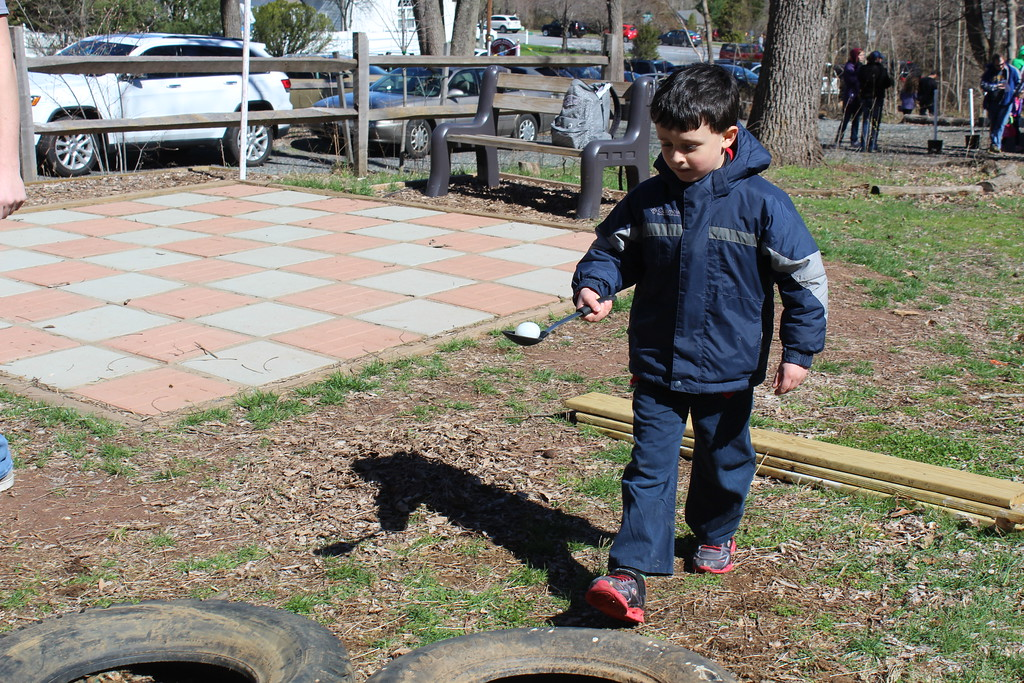 . River Blanco, 6, does an egg race at the Althouse Arboretum in Upper Pottsgrove on Saturday, April 8, 2017.