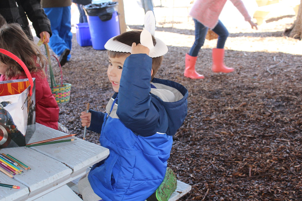 . Alex Cassel, 3, wears an bunny hat he made at the crafts table after doing an forest egg hunt at the Althouse Arboretum on Saturday.