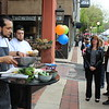 People gather around a fresh salsa demonstration during the Pottstown outdoor farmers market.