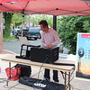 A DJ plays  music during the first Pottstown outdoor farmers market.