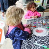 Children do arts and crafts during the outdoor Pottstown farmers market.
