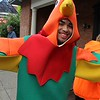 Pottstown High School student Anthony Santiago wears a rooster costume during the opening day of the Pottstown outdoor farmers market along High Street.