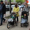 People walk downtown Pottstown along High Street during the first Pottstown outdoor farmers market.