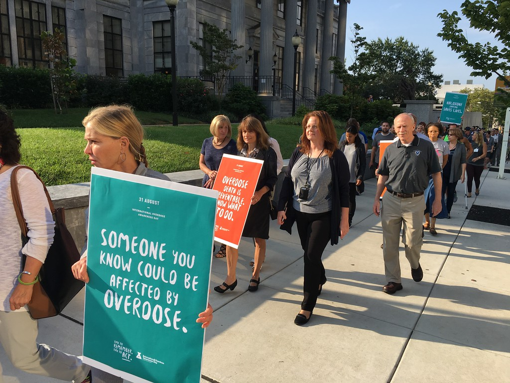 . Eric Devlin � Digital First Media Montgomery County officials marched around the Montgomery County Courthouse Thursday in a showing of solidarity against the opioid epidemic.