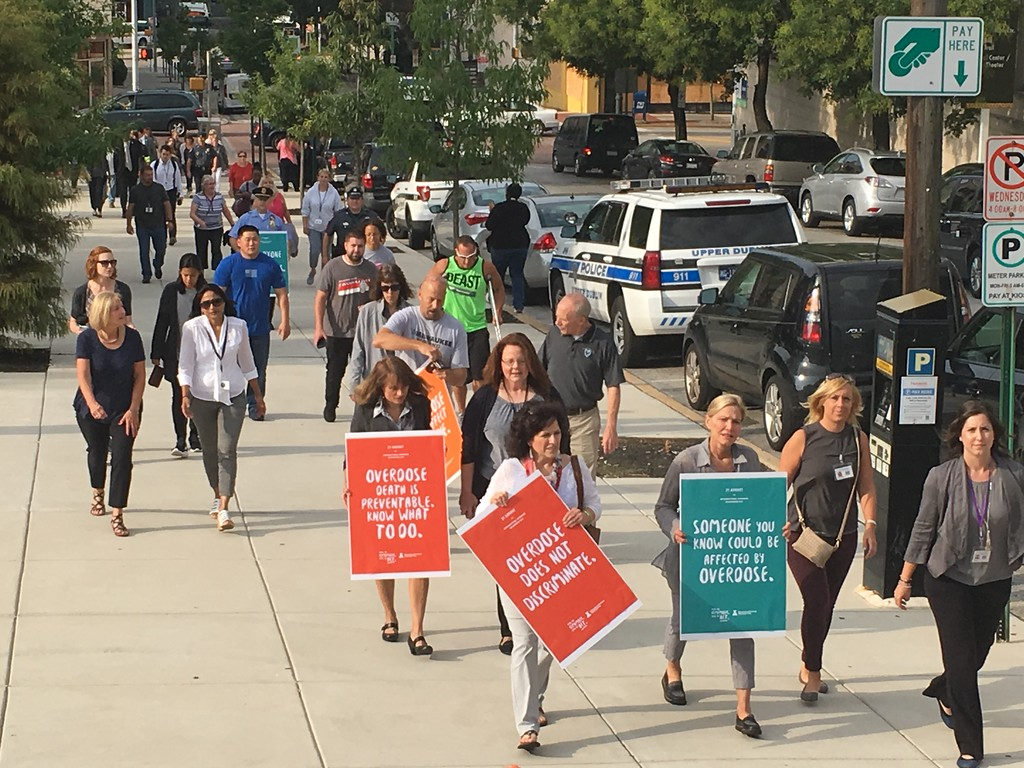 . Eric Devlin � Digital First Media Marchers took to the sidewalk around the Montgomery County Courthouse in a showing of solidarity against the opioid epidemic Thursday.