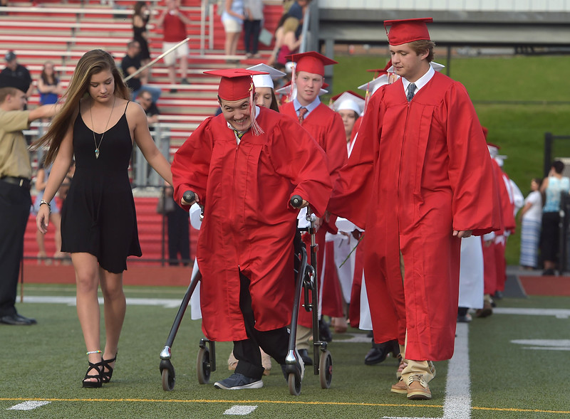 PETE  BANNAN-DIGITAL FIRST MEDIA           Owen J. Roberts  seniors Kyle  Noah Baldwin and Dylan Thomas Brandon enter the football field for commencement Friday evening.