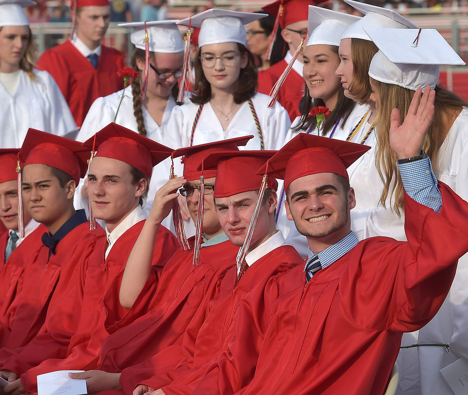 . PETE  BANNAN-DIGITAL FIRST MEDIA           Owen J. Roberts senior Francis Macon Summerill IV waves to family at the start of graduation which was held on in the school stadium Friday evening.