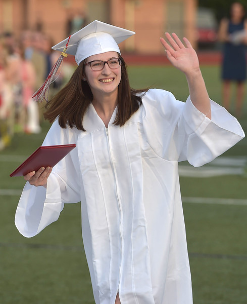 PETE  BANNAN-DIGITAL FIRST MEDIA         A happy Alison Josier Haines carries her diploma from Owen J. Roberts  after picking it up with 439 other OJR seniors Friday evening.