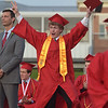 PETE  BANNAN-DIGITAL FIRST MEDIA           Owen J. Roberts  senior Wyatt Paul Fleck is excited to get his diploma during commencement exercises Friday evening on the school football field.